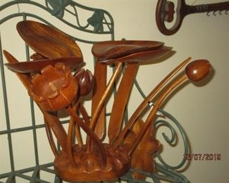 lots of wood carved figurines and decor