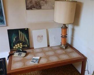 Basement Room Left:  MCM Tile Coffee Table, Table Lamp, Oil Paintings, Small vintage Phone