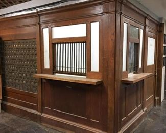 """Superb Original 1950s Complete United States Post Office Wooden Façade with original Bronze Mailboxes. It is 95"""" tall. The door side length is 106"""" long and the mailbox side is 132"""" long."""