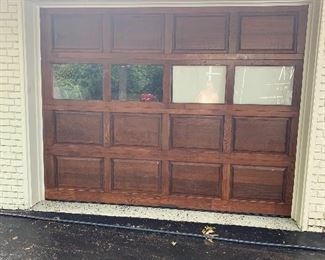 Single solid wood garage door with lift master