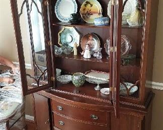 Two piece top and bottom break front, loaded with Royal Doulton, Wedgwood, etc.