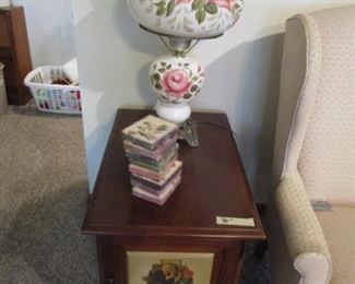 """Norman Rockwell"" Occasional table and storage chest.  Has front door and drawers on side."
