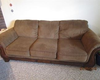 Brown fabric sofa.  In very good condition.  Pillows were not 'fluffed' when pic was taken.