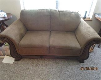 Brown fabric love seat