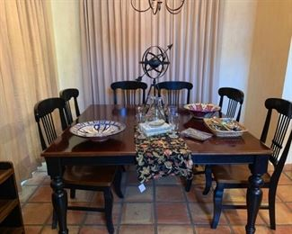 This table and chairs is sold but some of the stuff on top of it is still for sale.