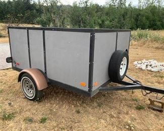"""Utility trailer - 8' long x 6' wide x 42"""" tall, with fold down rear panel."""