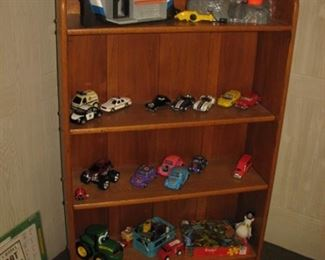 toys, model cars, bookcase