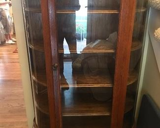 Early 1900's China Cabinet -  Looking at the front of this piece, the left side was replaced with plastic.  Glass is on the other two sections.    The wood is in good condition.