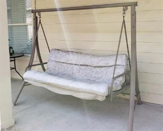 outdoor swing with cushion