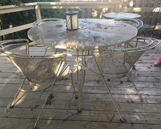 . . . this is one of three (count 'em, three!) wrought-iron patio sets.