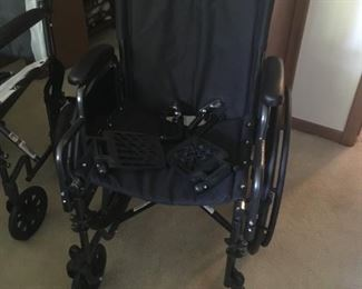 . . . practically new wheel chair.