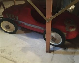 . . . this was hidden under a table, but I think it is an old pedal car!
