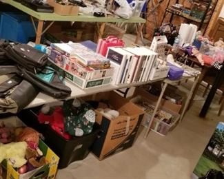 Bags, Disney movies, stuffed animals, plenty of VHS tapes, vintage dining room table with 4 chairs & 2 leafs...