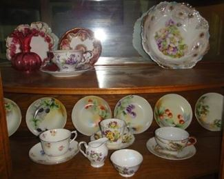 Vintage tea cups and painted dishware