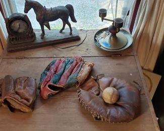 Close-up of baseball gloves.