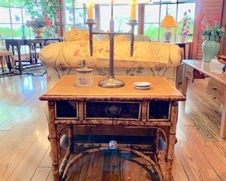 Antique English Rattan Occasional Table with Leather Top and Decorated Sides; Brass Lamp