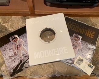 """Signed photo of Buzz Aldrin with companion book #143, """"Moonfire"""" by Norman Mailer."""