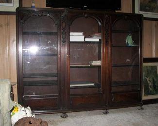Glass front bookcase 64 1/2 W x 51 1/2 H x 12 1/2 D