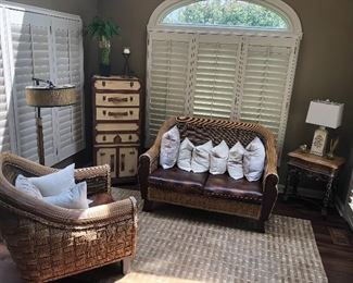 Sun room love seat, chair, table, tall suitcase chest, table, lamps and rug