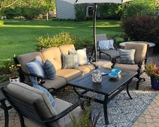 Patio furniture - Sofa, two chairs, end table, coffee table and cantilever umbrella
