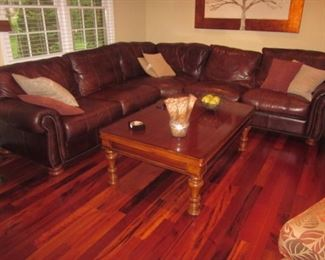 Leather Tufted Natuzzi Sectional Sofa.     Natuzzi Leather Chair with Ottoman
