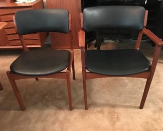 THERE ARE 6 TEAK AND  LEATHER CHAIRS / 2 ARM CHAIRS AND 4 SIDE CHAIRS