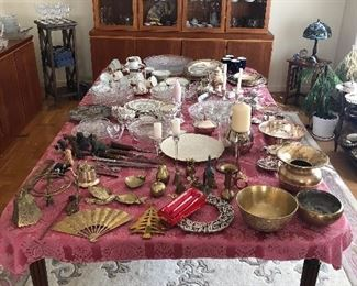 "Collection of china, brass, glass, and silver serving and decorative pieces, on full-size (52"" table with 2x leafs that seats 12)"