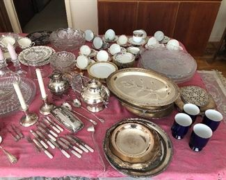 Collection of silver platters, mother of pearl handled fish knives, tea pots etc.