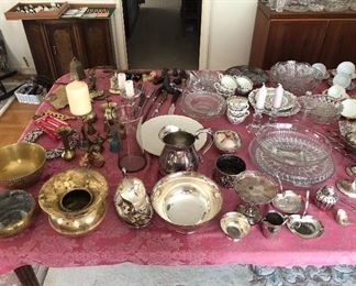 Collection of various silver serving pieces, replica Revere Bowl, brass items and candle sticks.
