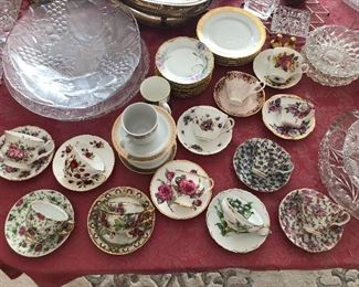 Collection of porcelain tea cups and saucers.