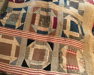Many vintage hand-made quilts