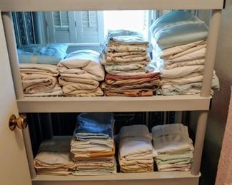 Lots of sheets towels and linens