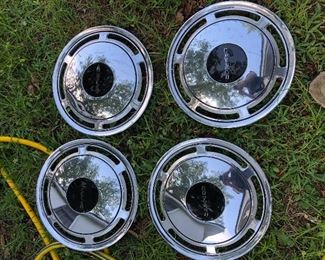 4 brand new vintage Caprice hubcaps
