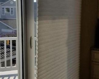 Hunter Douglas honeycomb blinds throughout
