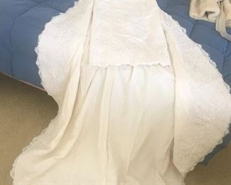 This is a custom made wedding dress in raw silk and hand made lace with beading.  Really beautiful  size 8