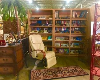 Massage chair, Persian rug, bookshelves, Louisiana jazz statues, leather top dresser, light up palm tree