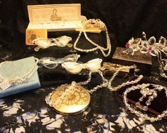 Very vintage cats eye glasses and a collection of Laguna crystal necklaces, in their original boxes.