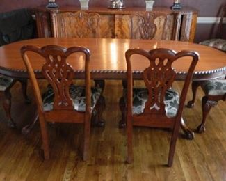 Eight Chippendale-style chairs.  $475.