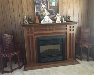 beautiful fireplace, works great, puts out heat and beautiful wood design. $275