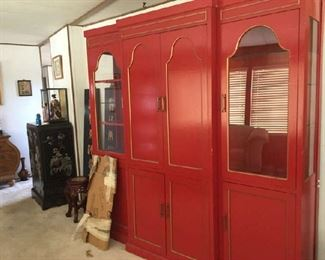 This is a huge and heavy cabinet. Originally there was glass shelves on the sides and they are in the box in front of the cabinet. It was a bar and in the middle cabinet the wooden top drops down and the bar is inside.   Priced to sell at $175