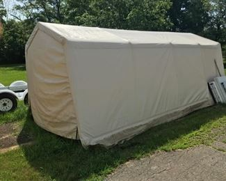 12 ft. x 22 ft. storage automobile shed sold new for $195 at Menards.  Now $125. (off site)