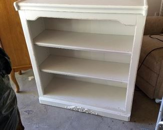 Wonderful display or book shelf, nicely painted white