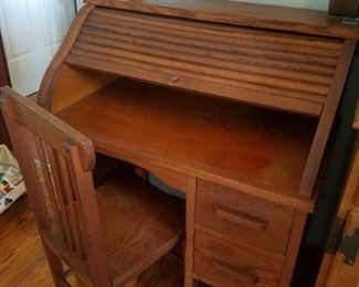 Child's Antique roll top desk and chair, excellent condition.