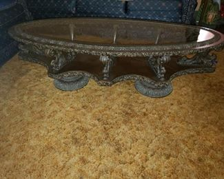 """Ornately carved mahogany table with glass table and carved metal feet. 60"""" x 25"""" x 17"""""""