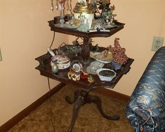 Tiered mahogany table with claw feet is the perfect corner table.