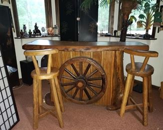 """Man Cave-o-Rama Bar!!! You don't see many of there.  Hand hewn with wagon wheel on front and matching bar stools.  While you are at it, get the palm tree and tropical elements to boot! 68"""" x 38"""" x 22"""" Palm tree over 7"""" with fronds"""