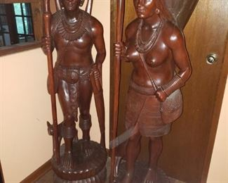 Amazing vintage teak travellers are intricately carved.  Crack in basket but otherwise clean pieces.  About 5' tall.