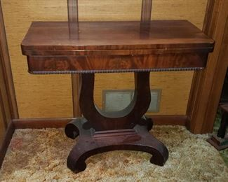 Antique gaming table is a great find.  Some discoloration from sun on top, but see just great.