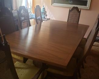 """Fabulous vintage yet timeless table is a stately piece for any dining room.   Table and chairs in very good condition.  Even the woven backs are in great condition.  Without the leaf it measures 80'x 44""""x 28"""""""
