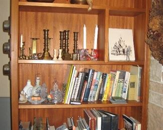 """Variety of brass and wooden candle holders, Scandinavian books and crystal, miscellaneous new photo albums and classic books, brass """"spittoon"""""""